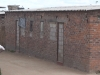 """There are 18 government-funded, """"Operation Garikai"""" houses in Hopley farm, Harare, where 3,800 displaced live: windows and doors have been bricked up because there are no door or window frames, and also no sewerage, water or electricity, five years after being built. [July 2010]"""