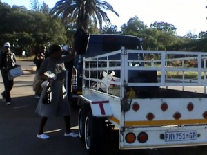 "Report Cover Photo: Zimbabweans in Bulawayo board the ""Omalayitsha"" to Johannesburg, June 2009"