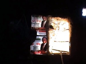 Report Cover Photo: In a brave act of defiance, posters of Morgan Tsvangirai hang on the wall of a hut burnt by ZANU PF supporters in Shamva, April 2008