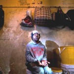 Report Cover Photo: Blind Zimbabwean in the room he shares with other blind friends in Johannesburg