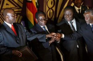 Signing of the GPA. From left to right: Arthur Mutambara, Robert Mugabe, Morgan Tsvangirai and Thabo Mbeki