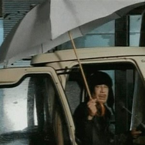 Gaddafi appears on Libyan state television clutching an umbrella
