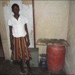 A pregnant woman stands in her empty kitchen, rural Gwanda, October 2011.
