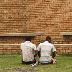Relatives pray outside after visiting detainees inside Lindela Detention Centre, Krugersdorp, South Africa